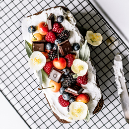 Healthy Ginger Loaf with Coconut Whipped Cream, Summer Berries & Chocolate